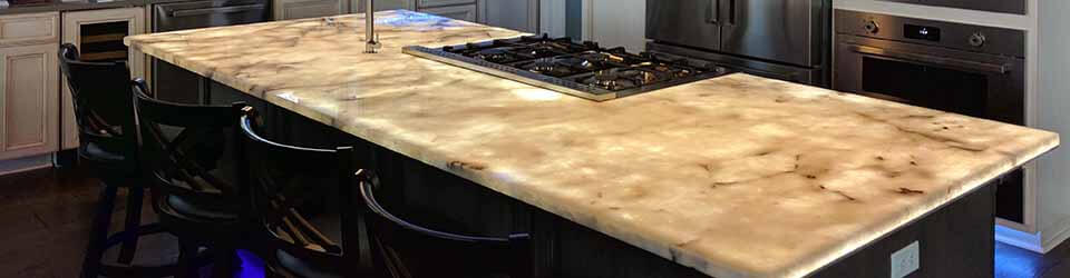 LED backlighting for kitchen counters and other translucent surfaces